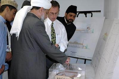 Huzur advising the Architect of the Mosque Baitur Rehman