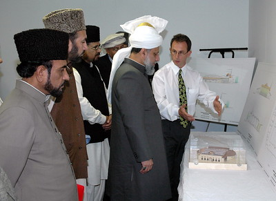 The Architect explains some of the features of the roof on the model to Huzur
