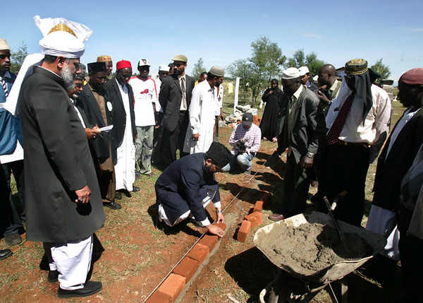 Abdul Majid Sahib places a brick on foundation Eldoret
