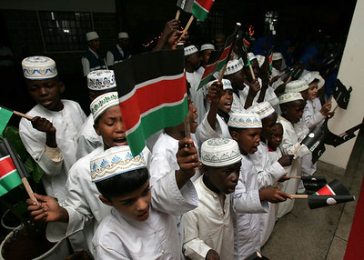 Boys wave flags and sing in Nairobi