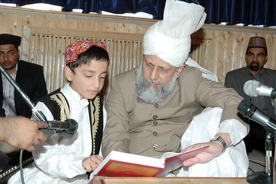 Huzur listens to a child reading the Qur'an