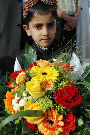 Waqf-e-nau child is waiting with flowers for Huzur