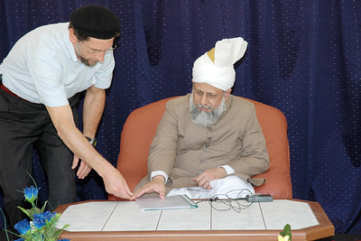Amir Sahib showing Huzur the program