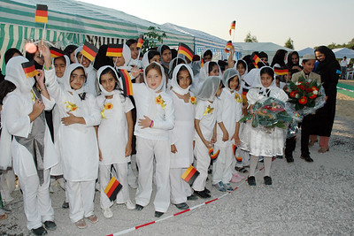Children waving with flags