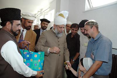 Huzur gives chocolates to children