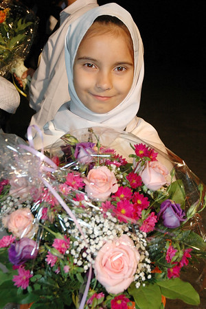 Waqf-e-nau girl waitng with flowers for Begum Sahiba
