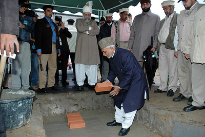 Chaudhry Hameedullah Sahib Wakil-e-Aala Therik-e-Jadid lays the foundation stone
