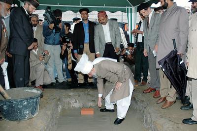 Huzur laying the foundation stone