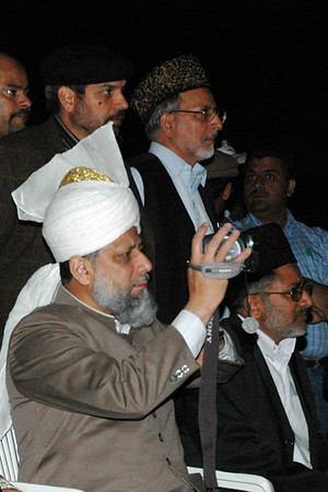 Huzur capturing the water and light show with a video camera