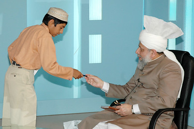 Huzur gives pen to Waqf-e-Nau