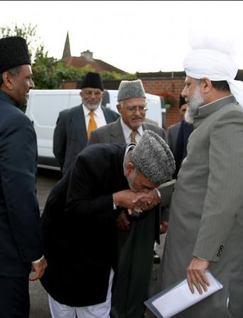 Principal Laeeq Ahmad Tahir sahib greets Huzur