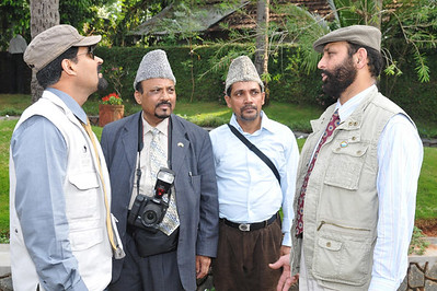 Huzur's personal staff in discussion