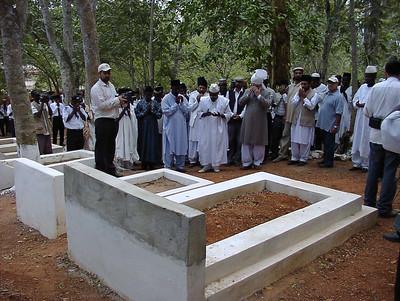 Hazrat Khalifatul Masih V offering prayers at grave of first Ghanian Ahmadi Chief Mahdi Appa