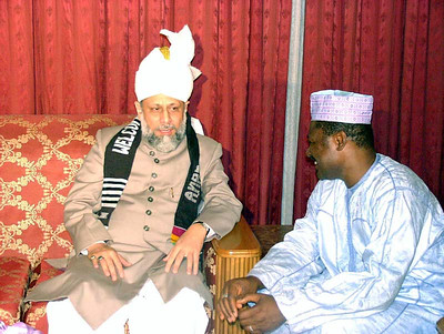 Huzur at the presidential arrival lounge talking with presidential press secretary