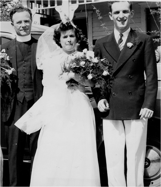 Mom and Dad Wedding 1939 Father Harvey Bessette, Marietta Amyot Bessette, Leo Bessette in front of 143 Central Cohoes