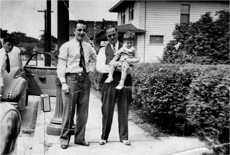 Leo Bessette and Oldilas Amyot (mom's dad) hold Pete at 143 Central Cohoes circa 1941 Paul Amyot at left