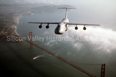 C-5 Galaxy Air Mobility Command flying over the Golden Gate Bridge in San Francisco, c. 1982