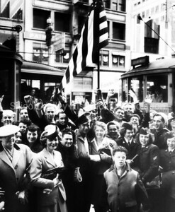 Crowd of people celebrating in the streets of San Francisco after WWII was over