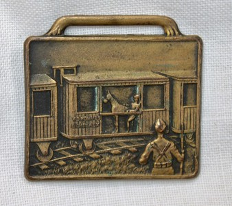 World War II Brass Buckle showing soldier in train car with horse