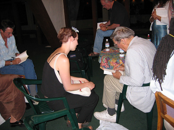 Galway Kinnell signs a book  - 2004