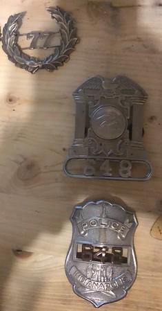 Badges of Officer John L Wilson 648 and 77