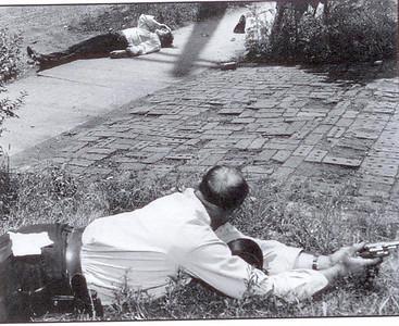 Dora Ward lies semiconscious, Melvin Jordan in foreground.