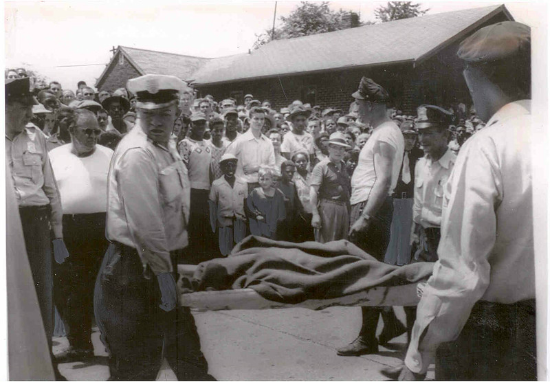 Suspect Howard Ellis is carried to the morgue after the incident ended.