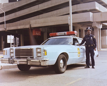 Light Blue Ford IPD Police Car