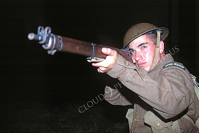 HR-BRAWWIIS 00001 A British Royal Army World War II soldier historical reenactor aims his rifle, by Peter J Mancus