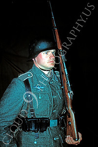 HR-WWIIGAS 00003 World War II German army soldier historical reenactor stands guard with a rifle at night, by Peter J Mancus