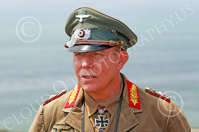HR-WWIIGAS 00002 A convincing re-enactment of WWII German Army Field Marshall Erwin Rommel known as The Desert Fox, looking at the English Channel, historical re-enactor picture by Peter J Mancus