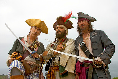HR-PIR 00001 Three historical reenactor pirates hold their swords and one holds a skull, by Peter J Mancus