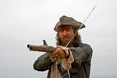 HR-PIR 00026 A gruffy historical reenactor pirate with his weapons, by Peter J Mancus