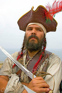 HR-PIR 00002 An historical reenactor pirate holds his sword, by Peter J Mancus