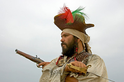 HR-PIR 00024 A historical reenactor pirate holds weapons, by Peter J Mancus