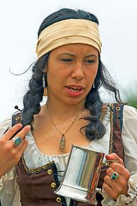 HR-PIR 00011 A female historical reenactor pirate holds a mug, by Peter J Mancus