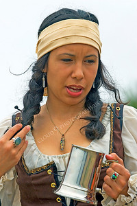 HR-PIR 00011 A female historical reenactor pirate holds a mug, by Peter J Mancus