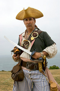 HR-PIR 00023 A historical reenactor pirate holds his skull and sword, by Peter J Mancus