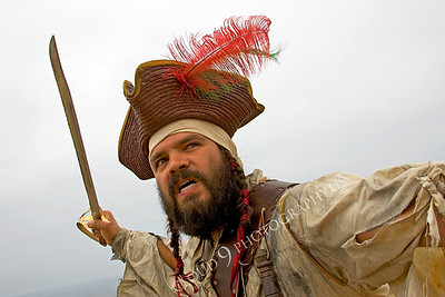 HR-PIR 00012 A historical reenactor pirate prepares to thrust his sword, by Peter J Mancus