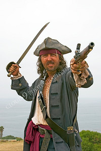 HR-PIR 00005 A historical reenactor pirate aims a pistol, by Peter J Mancus