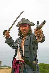 HR-PIR 00005 A historical reenactor pirate aims a pistol, by Peter J Mancus