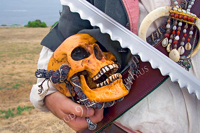 HR-PIR 00003 A historical reenactor pirate holds a skull, by Peter J Mancus