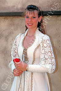 HR-RME 00021 A Renaissance Medieval Europe era historical reenactor princess holds a red flower, by Peter J Mancus