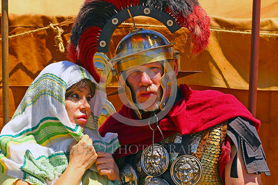 HR-RL 00402 Portrait of a loving wife looking at her senior Roman Legion commander husband with a fancy helmet and medals, Roman Legion historical re-enactor by Peter J  Mancus