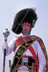 HR-SC 00001 A Renaissance Medieval Europe era historical reenactor wears an elaborate Scottish clan outfit, by Peter J Mancus
