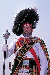 HR-SC 00001 A Renaissance Medieval Europe era historical reenactor wears an elaborate Scottish clan outfit, by Peter J Mancus