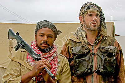HR-TWI 00004 A Black Third World insurgent with rifle reenactor with a caucasian British Royal Army military advisor reenactor, by Peter J Mancus