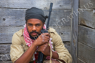 HR-TWI 00008 A Third World insurgent with rifle reenactor with a haunting, focused, stare, by Peter J Mancus