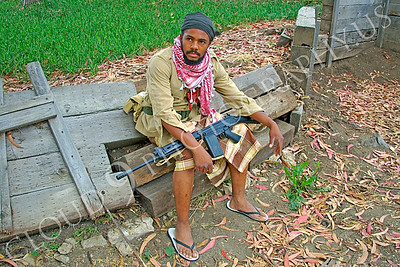 HR-TWI 00006 A Third World insurgent with rifle and flip-flops, not boots, reenactor, by Peter J Mancus