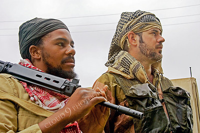 HR-TWI 00009 A Third World insurgent with rifle reenactor with a British Royal Army advisor reenactor, by Peter J Mancus